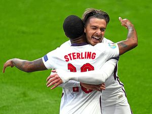 England's Raheem Sterling (left) celebrates scoring their side's first goal of the game with Jack Grealish during the UEFA Euro 2020 Group D match at Wembley Stadium, London. Picture date: Tuesday June 22, 2021. PA Photo. See PA story SOCCER England. Photo credit should read: Mike Egerton/PA Wire. RESTRICTIONS: Use subject to restrictions. Editorial use only, no commercial use without prior consent from rights holder.