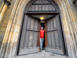WALSALL COPYRIGHT EXPRESS&STAR TIM THURSFIELD-27/11/20 Dr John Edlin, admires the newly restored doors at St Matthews Church, Walsall. An anonymous donor enabled the doors to be repaired after a vandal tried to gain access through the wooden doors by setting fire to them. .