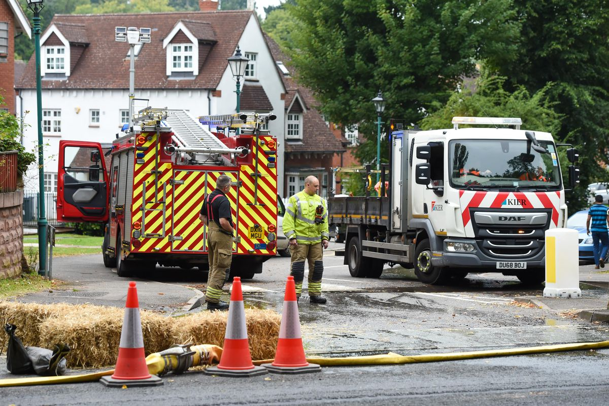 Firefighters and Severn Trent workers at the flooded road in Northfield, Birmingham. Photo: SnapperSK
