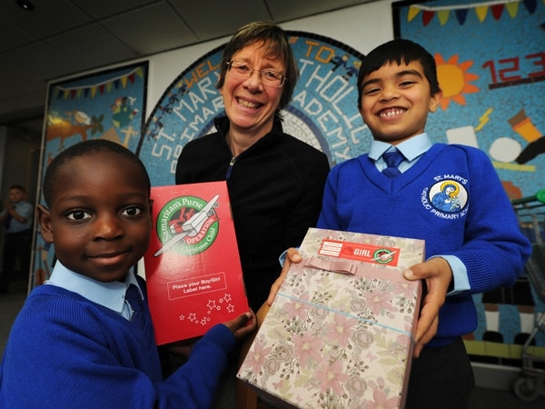 School children in Wolverhampton fill shoeboxes for Eastern European youngsters