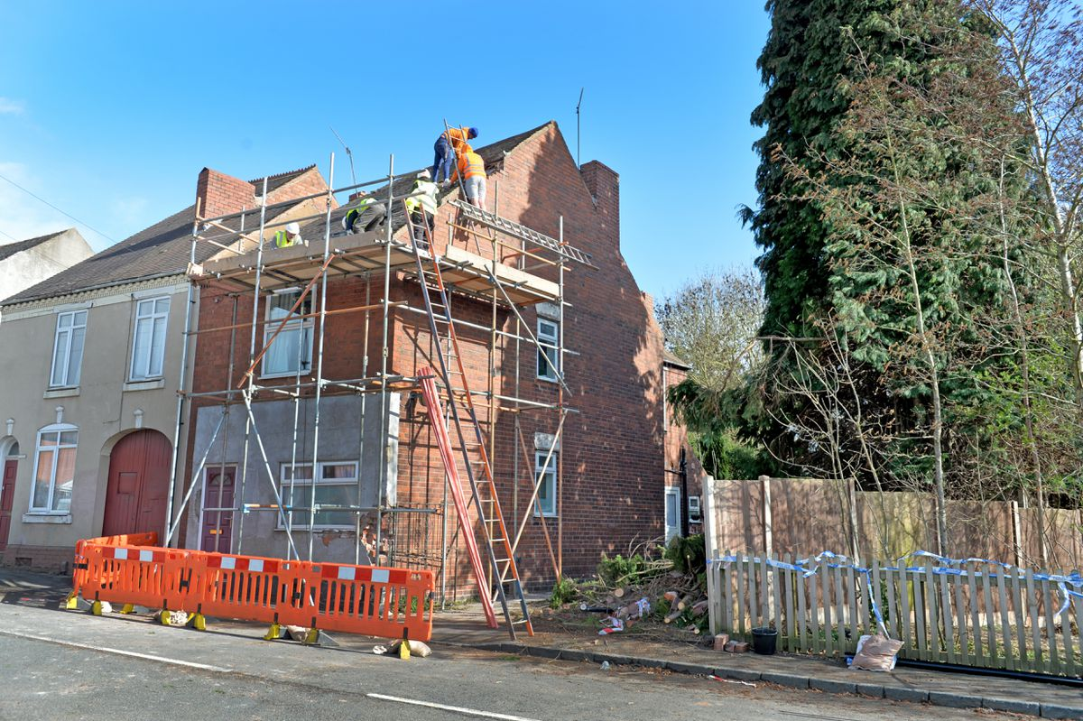 A tree fell into a house on Overend Road, Halesowen, during the strong winds last night and destroyed the front chimney. Pictured, work already underway to repair the damage to the roof.