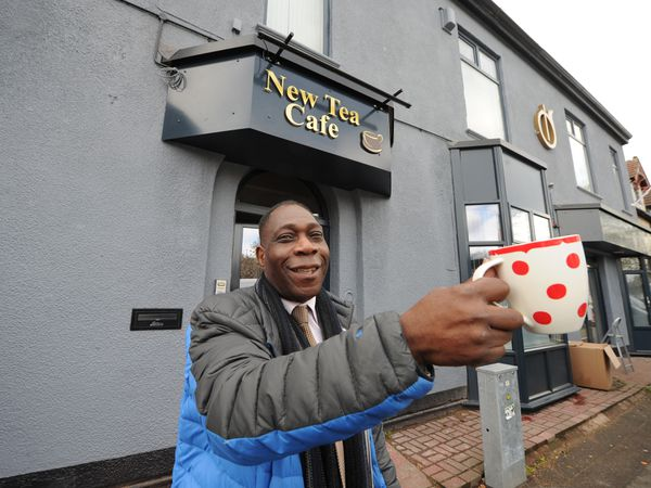 Pastor Albert Watson raises a cup to the new cafe at the New Testament Church of God Bilston