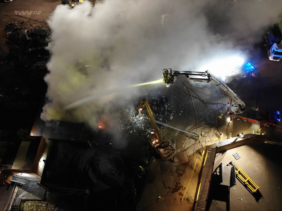 Fire crews use a hydraulic platform to douse the flames, guided by a drone. Photo: West Midlands Fire Service