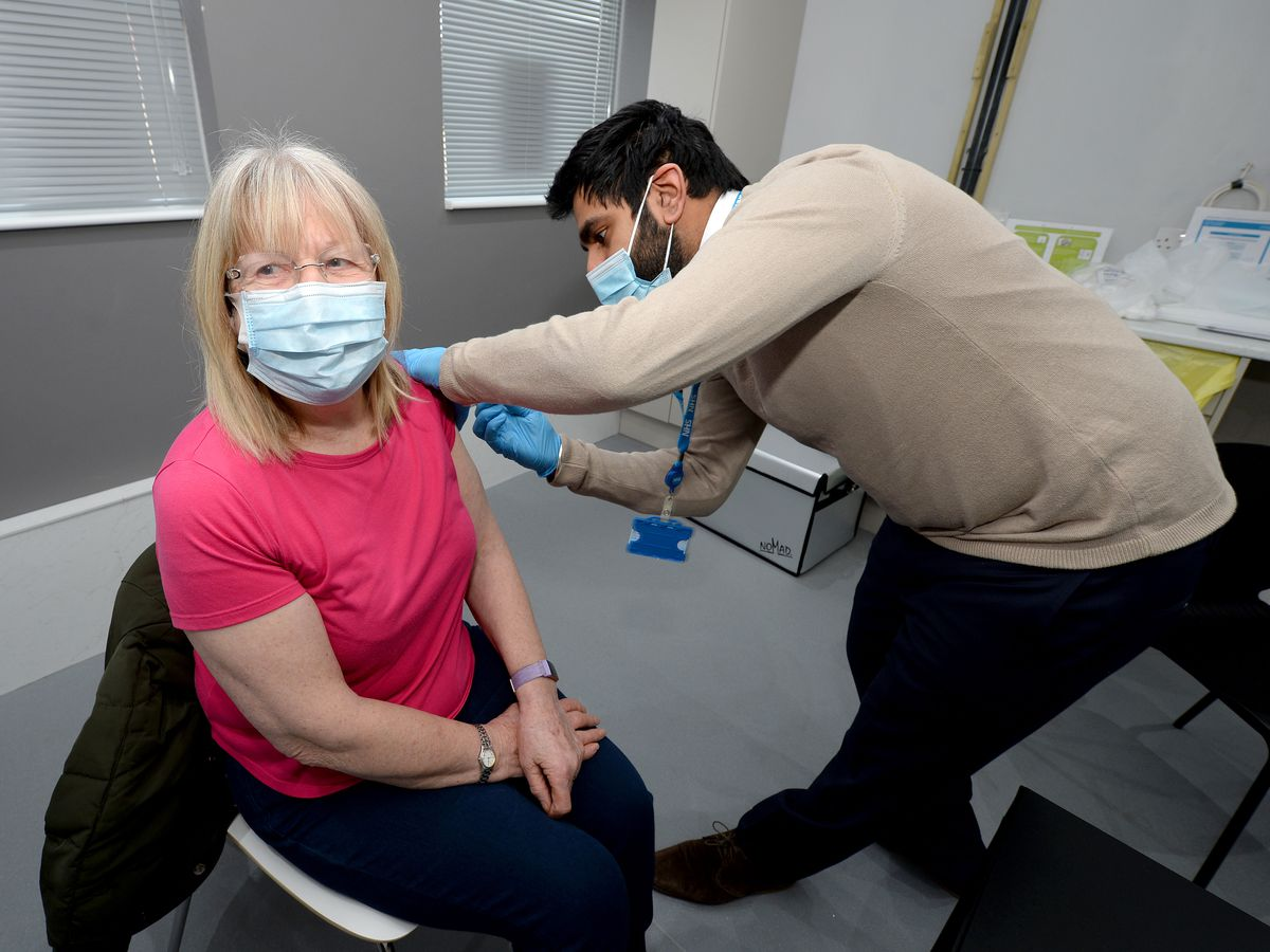 Local resident Valerie Owen gets the jab from clinical pharmacist Nitin Saul at Nucare Pharmacy in Norton Canes