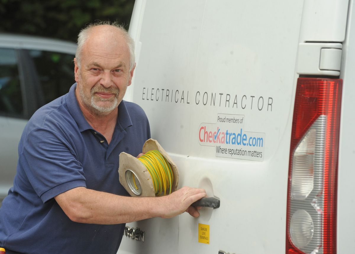 Ray Taylor, of Wolverhampton, with the van door that he has electrified
