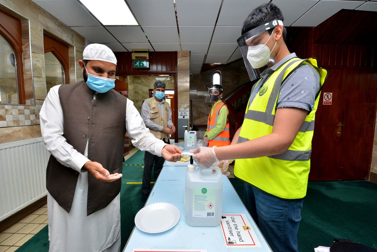 All people entering the mosque are required to wear masks and apply hand sanitiser when they enter.