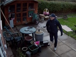 Can you help police trace this man seen wandering through back gardens?