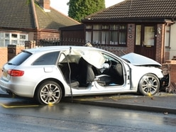 Men left in 'serious condition' after car hits wall in Bilston