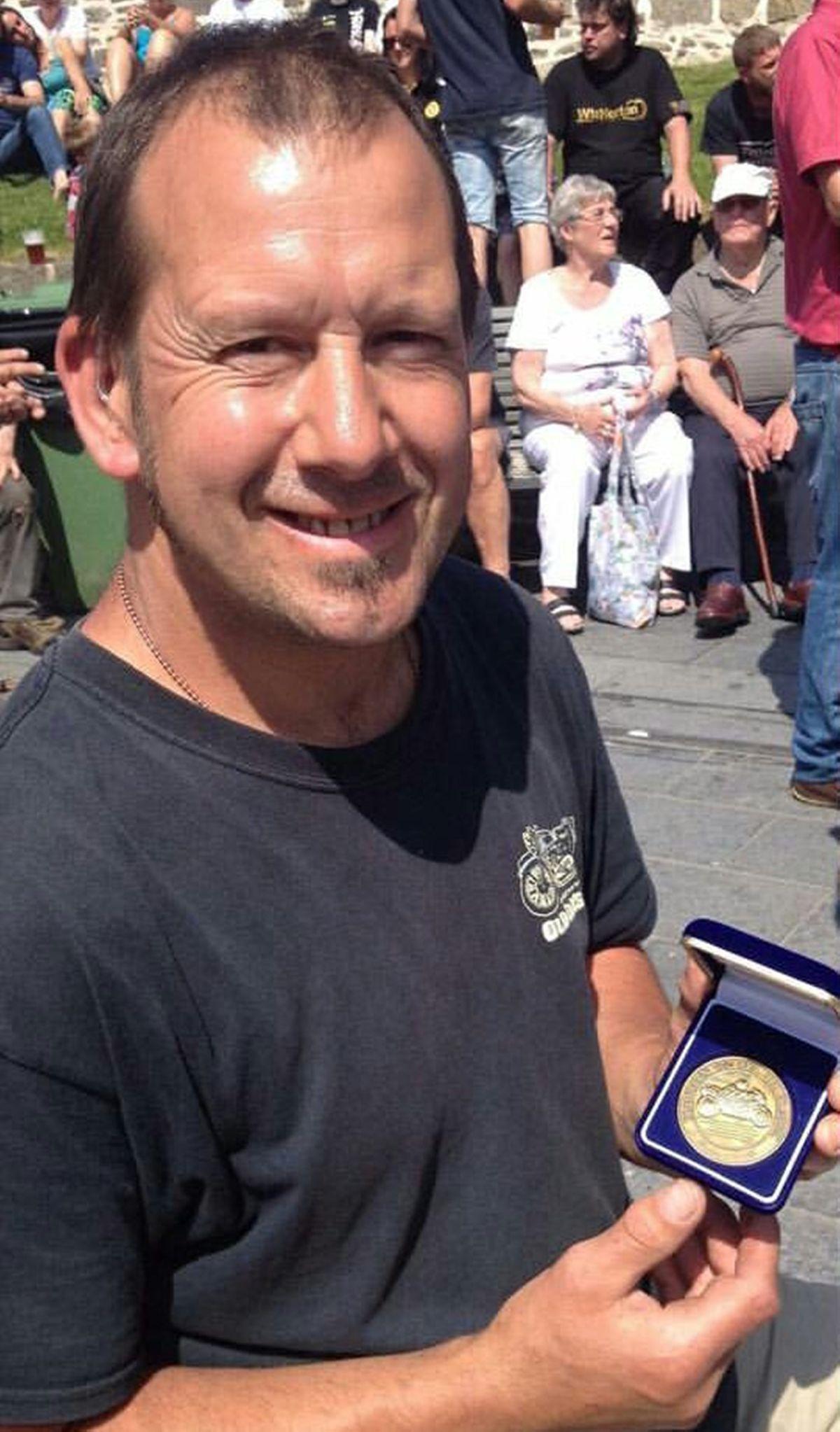 Neil Lloyd, aged 49