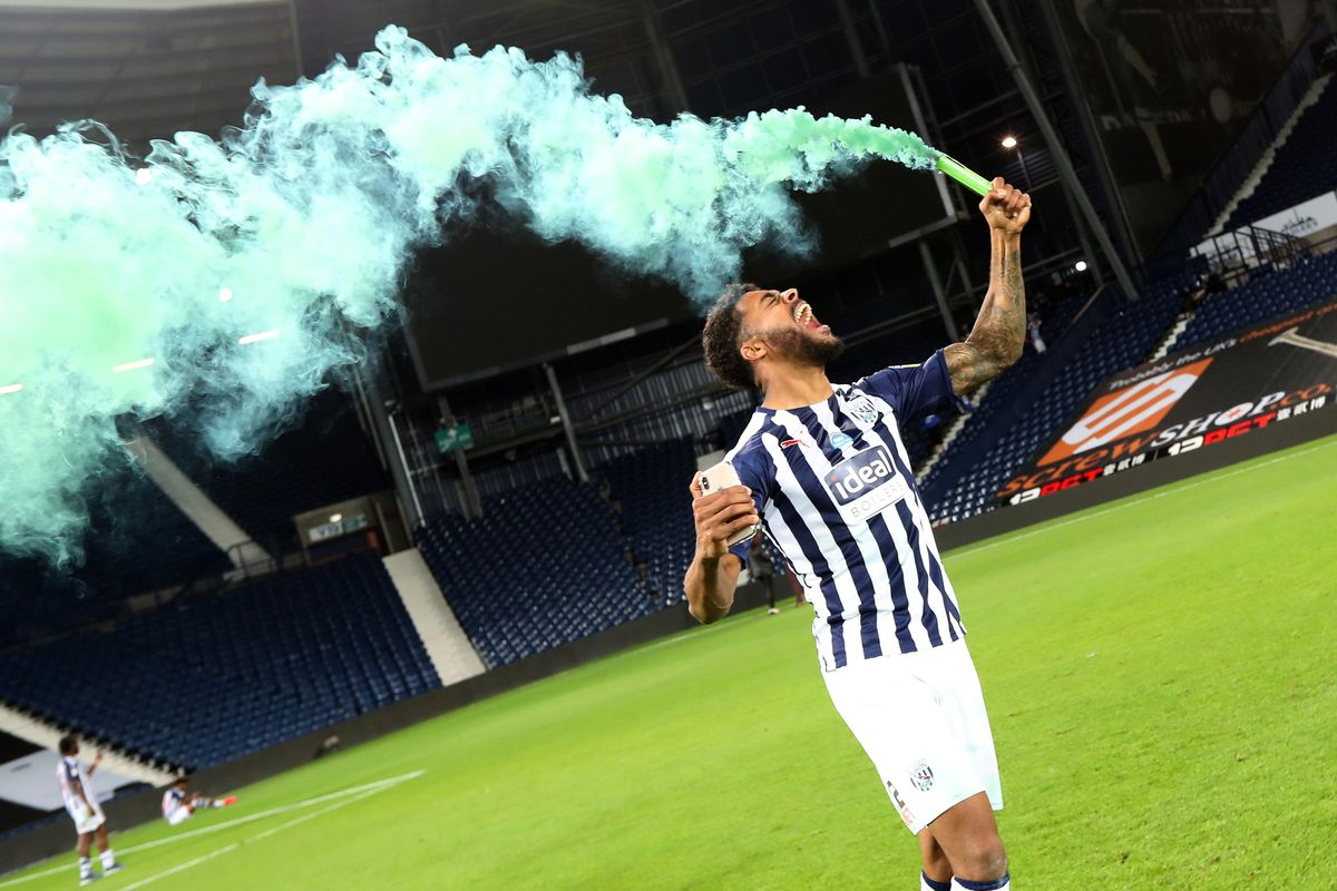 Darnell Furlong of West Bromwich Albion celebrates promotion to the Premier League on the pitch at the end of the match. (AMA)