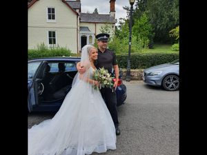 Lydia Evans-Hughes with the police officer who helped to get her to the church