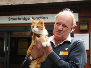 George the Cat with station supervisor Ian Tomlinson