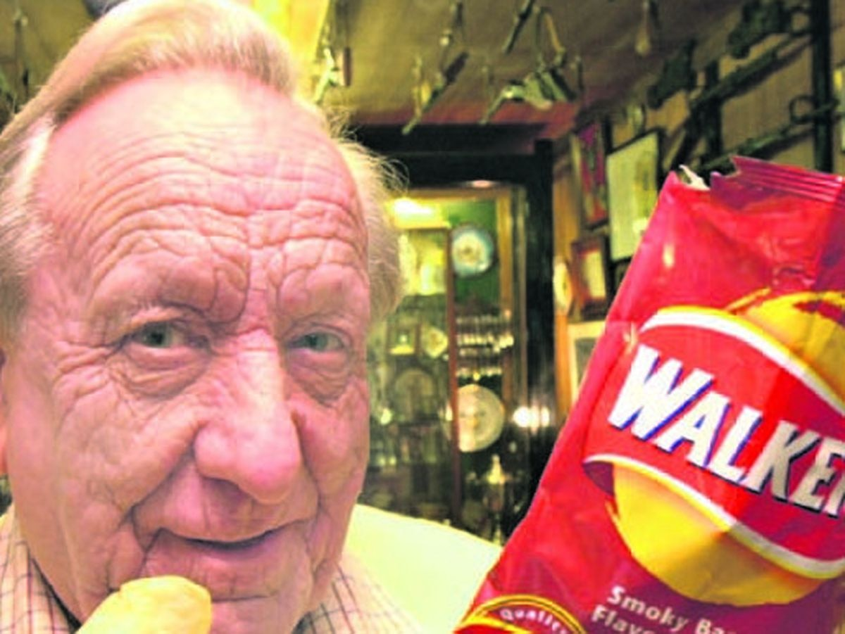 Frank Spittle with a bag of Walkers crisps