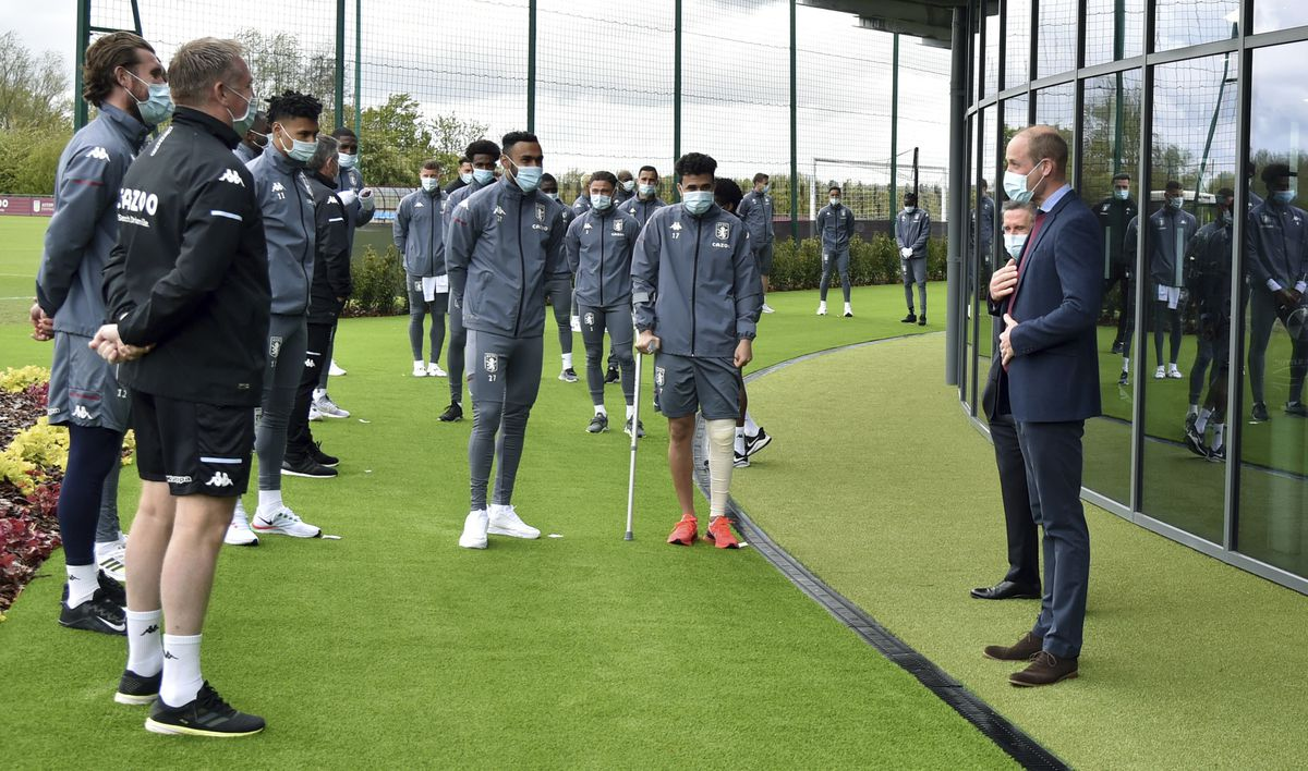 The Duke of Cambridge speaks to Aston Villa players during a visit to Aston Villa's High Performance Centre