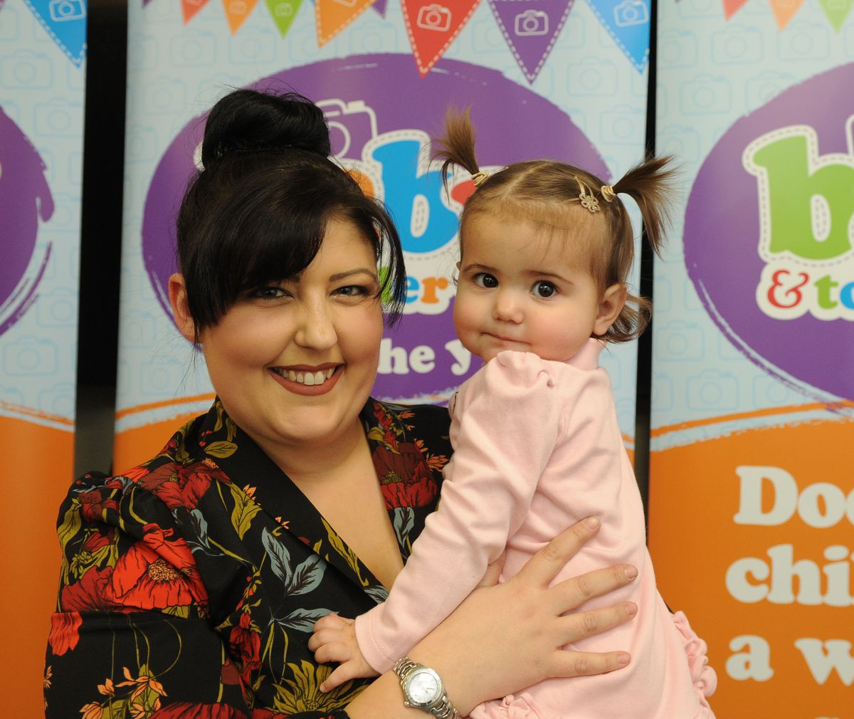 Winner of the 10 to 18 months category Esme-Rose Marsh, with mother Letitia Lock
