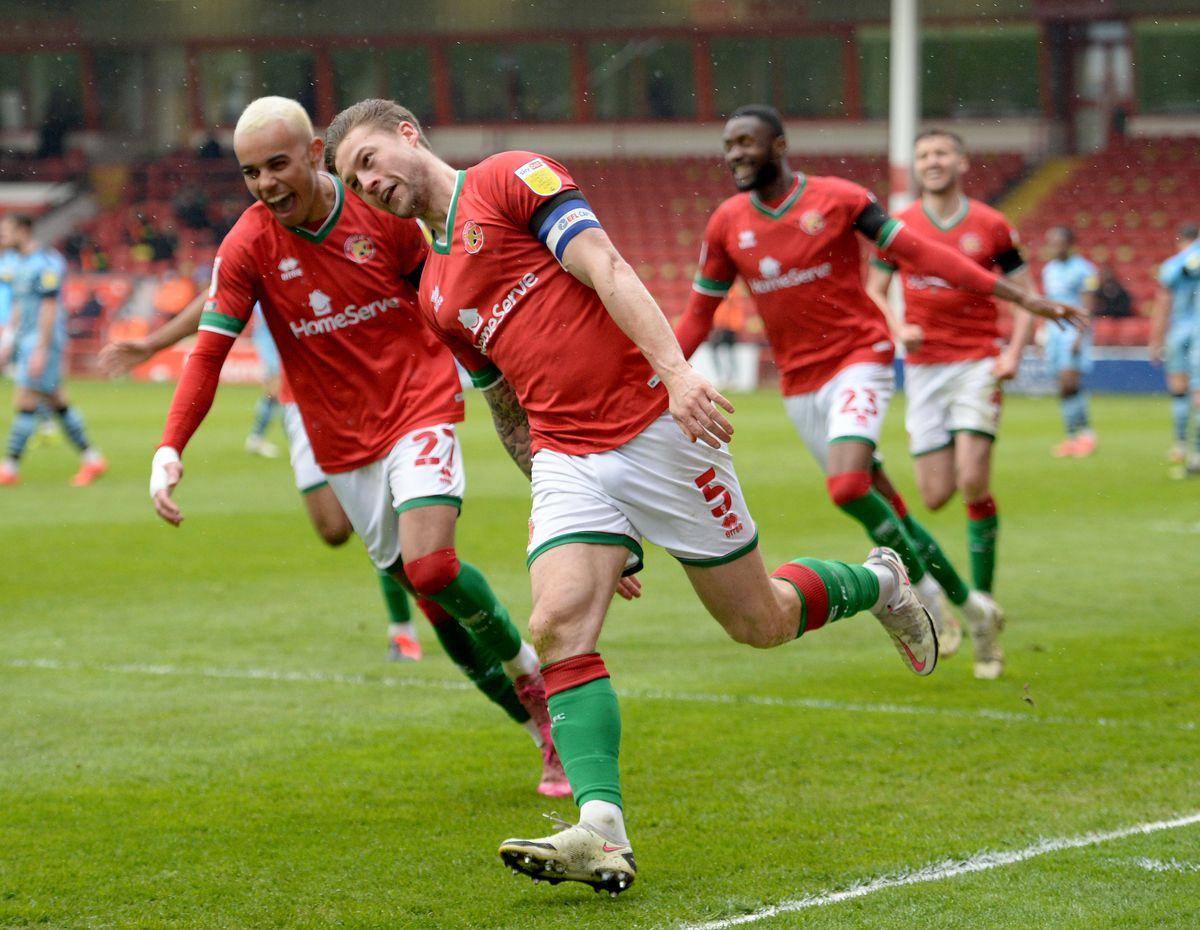James Clarke scores and celebrates.