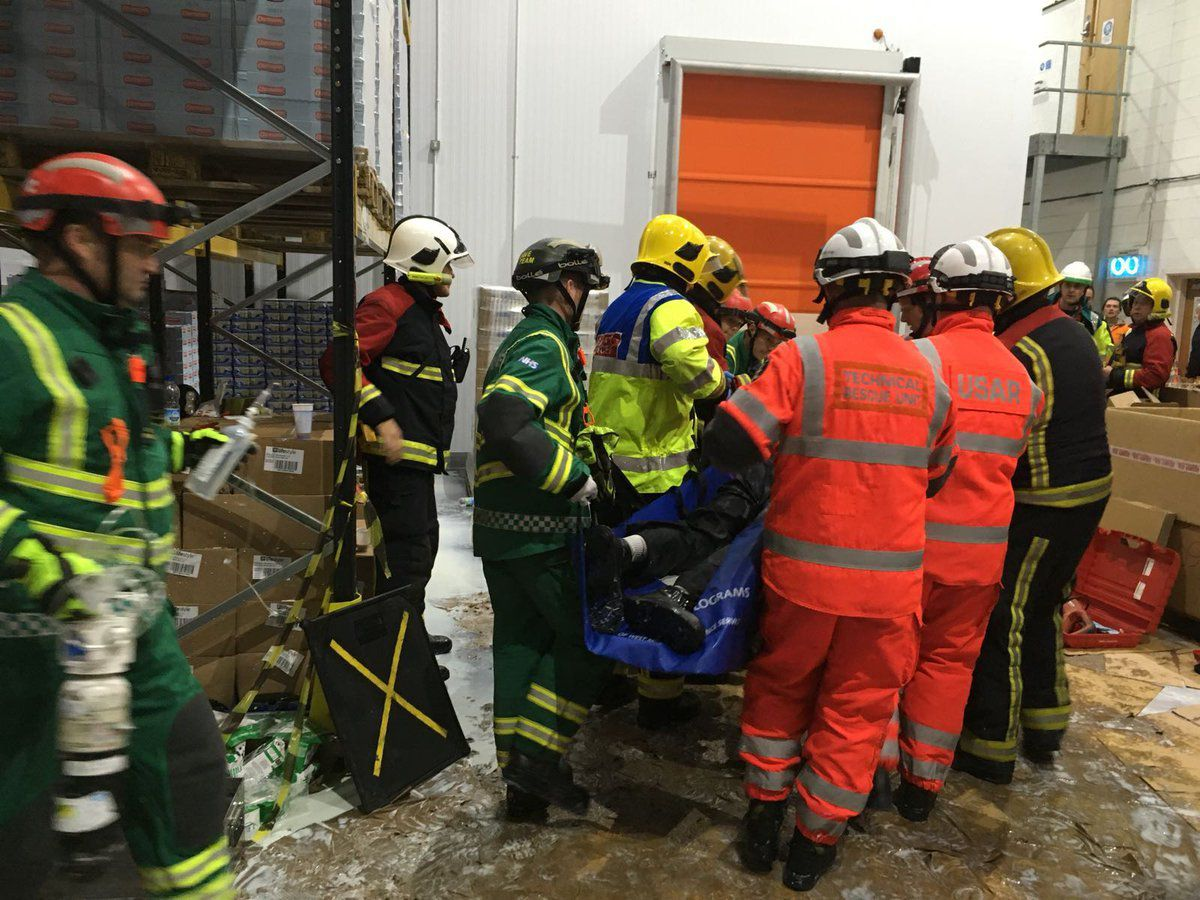 The man is stretchered away. Photo: @TechRescueWMFS