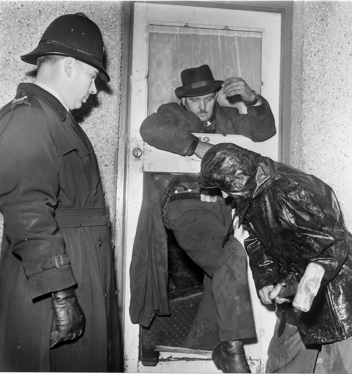 This dramtic picture of a balliff smashing down the door of the Coombes family home in Tipton during their eviction in 1965.    In the 60's there where many evictions in the Black Country and this is just one of many I covered.