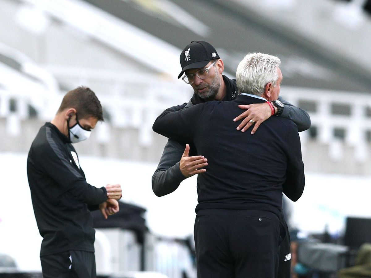 Liverpool manager Jurgen Klopp and Newcastle head coach Steve Bruce embrace after the final whistle