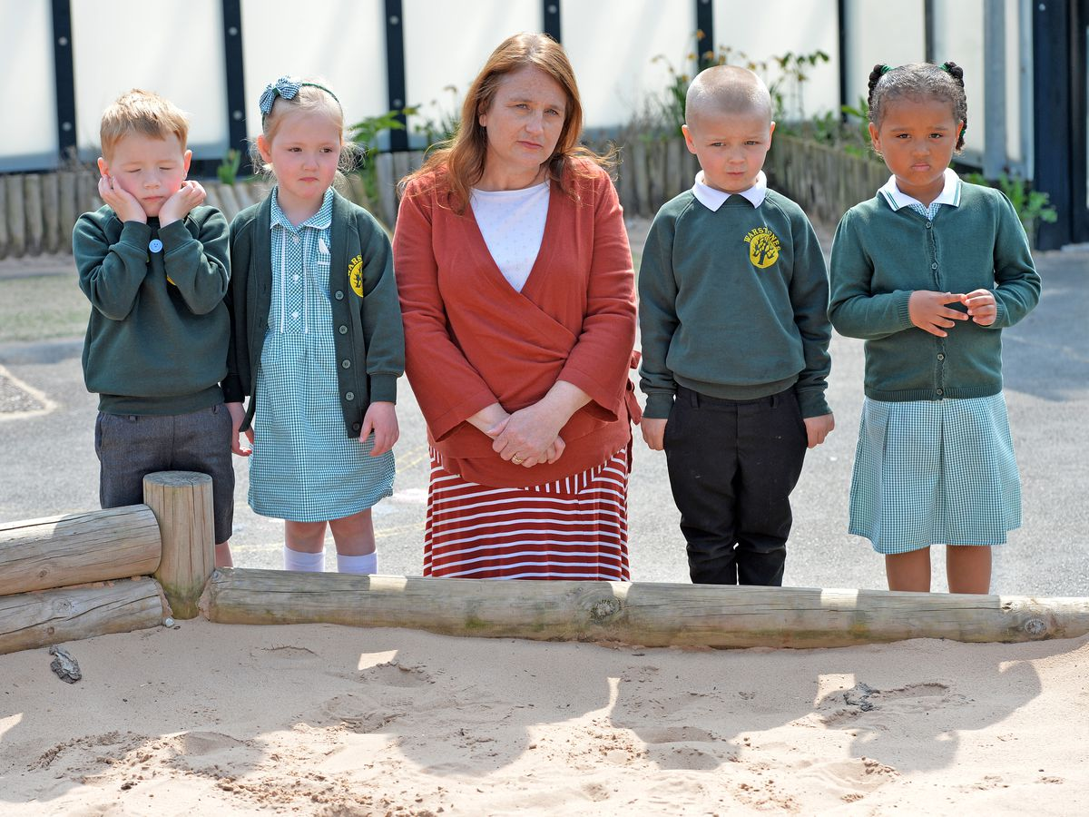 Vandals have smashed glass and relieved themselves in the sandpit at Warstones Primary School in Wolverhampton. The sand in the outdoor sandpit need to be replaced and until then children are not allowed in it. Pictured with Helen Brown are (L-R) Leo, Indie, Chase and Harleigh