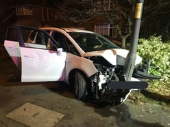 Man flees after late-night collision sees car smash into lamppost