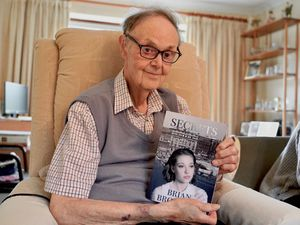 Brian pictured with his book Secrets after becoming an author for the first time at 84