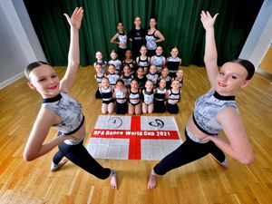 Repertoire Dance & Performing Arts, getting ready for the Dance World Cup in Telford. Front is:  Autumn Hickey 13 and Amber Hickey 15, with more dancers at the back..