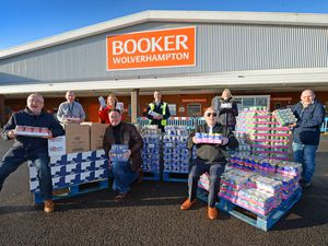 Former Goodyear workers have donated £5,000 of food and toiletries to The Good Shepherd and The Well. Pictured celebrating are Paul Burns and Helen Holloway from the Good Shepherd, Jim Munro, branch manager at Booker, Caroline Price from The Well and Mick Dutton, Cyril Barrett, Roy Dudley and Paul Baugh from Goodyear