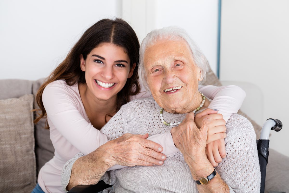 Portrait of happy grandmother and daughter embracing each other