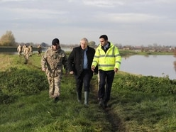 'You've took your time Boris': Johnson criticised during visit to flood-hit area