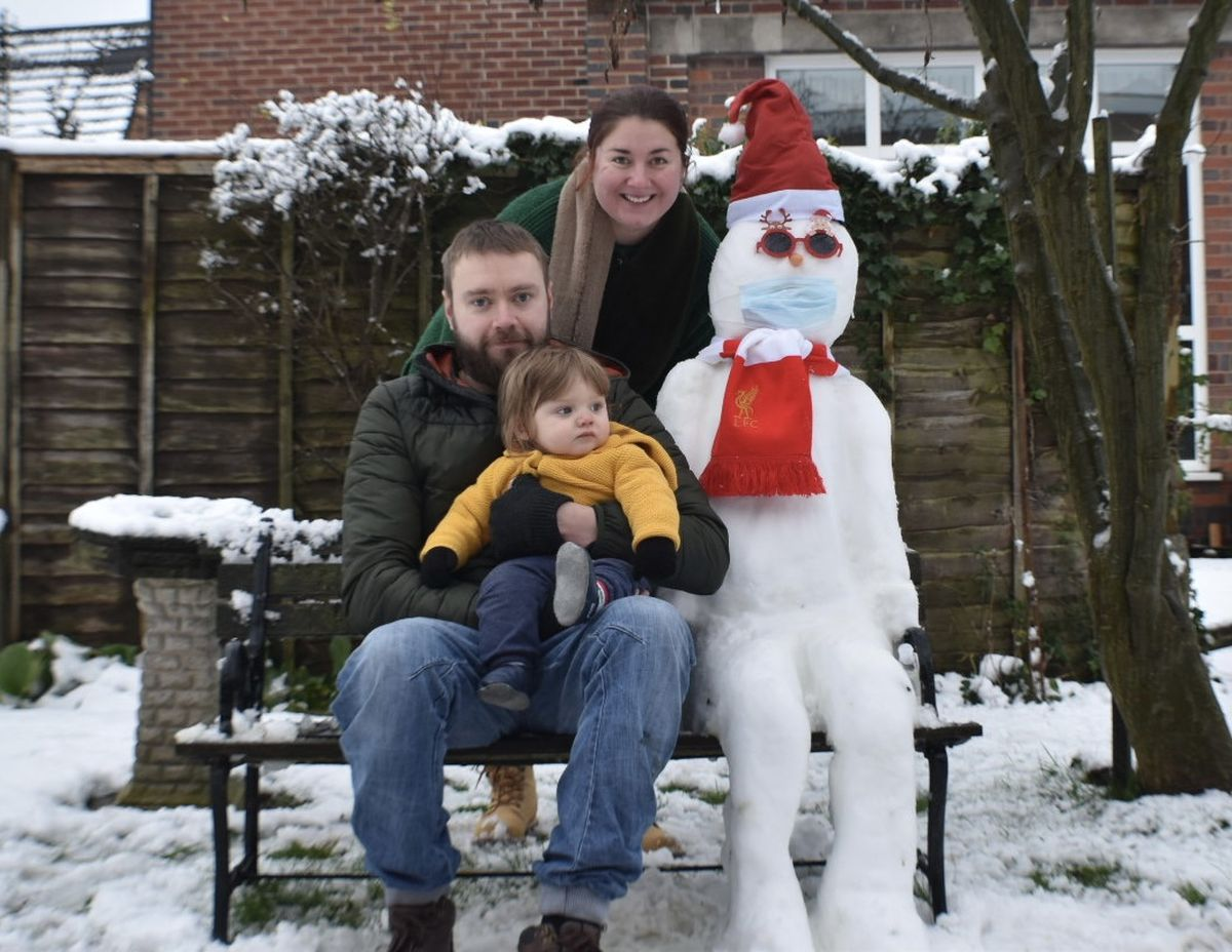 Amy Poultney and family in their back garden in WV3
