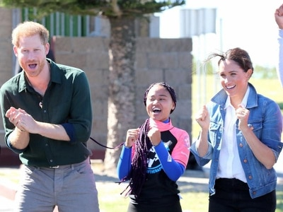 In Pictures: Surf's up! Harry and Meghan hit the beach in South Africa