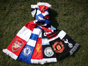 A selection of scarves pictured at Hackney Marshes, London, of the English soccer Premier League teams (left-right) Arsenal, Chelsea, Liverpool, Manchester City, Manchester United and Tottenham Hotspur, who announced in a joint statement they are to join a new European Super League
