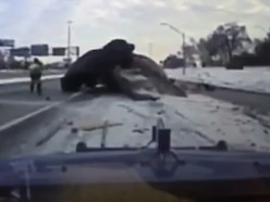 In video: Dash-cam captures moment car flies up tow truck ramp