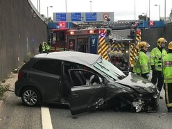 Car smashes into ambulance after driver falls asleep at the wheel on A38