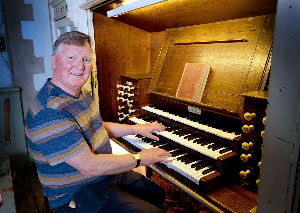 Tim Lees with the organ at St John's Church in Dudley