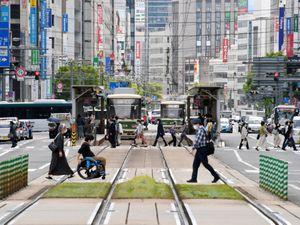 People wearing face masks make their way in Hiroshima, western Japan