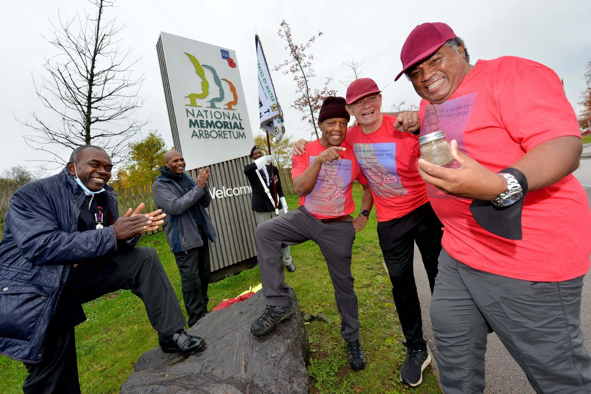 Wayne Howell, Stephen Disney and Noel Roye arrive at the National Memorial Arboretum with a vial of sand from Ayr. They are joined (L to R) by Winston White (Chair of the TNCMC), former Watford and England footballer Luther Blissett and standard bearer Kenneth Straun.