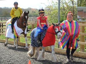 STAFFS PIC / DAVID HAMILTON PIC / EXPRESS AND STAR PIC 2/5/21 Taking part in a fancy dress fundraising riding challenge, at Norton Hall Farm and LAW Equine, Norton Canes..