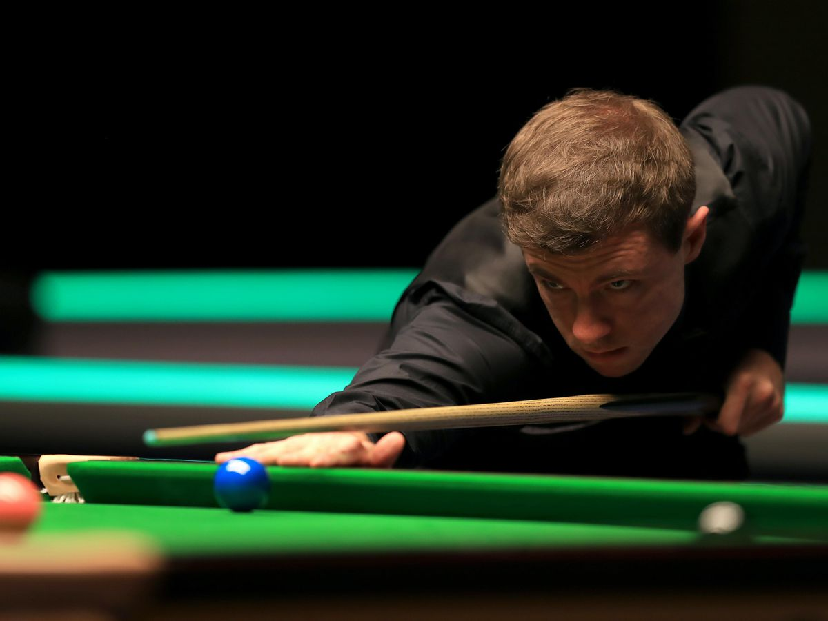 Snooker player Jack Lisowski in action