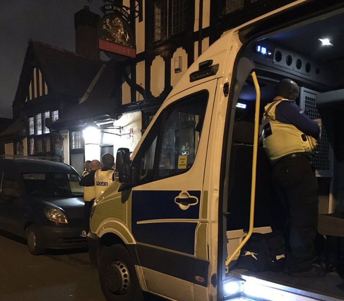 Police outside the New Junction pub. Photo: @BilstonWMP