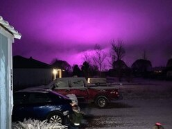 Lights from medical marijuana farm turn sky purple in Arizona town