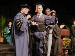 Watch: Quadriplegic student walks at graduation with help of exoskeleton