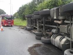 Driver injured after lorry overturns blocking Brownhills island
