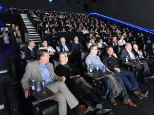 Guests take their seats for the first film showing