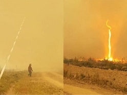 Watch this fire whirl suck a water hose into the sky in Canada