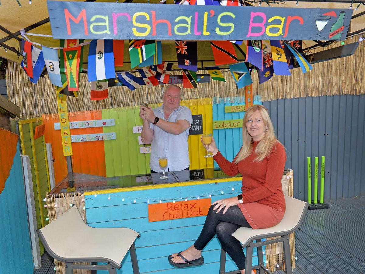 Mark and Lynn Marshall have created a Caribbean beach bar in their back garden during lockdown.