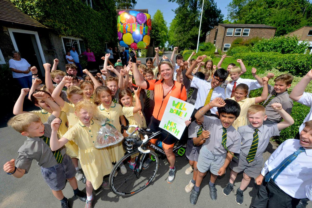 Alexandra Heath is cheered on by pupils after her epic journey