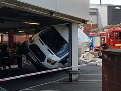 Driver stuck after wedging van under Tesco car park
