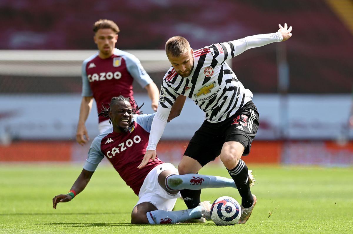 Aston Villa's Bertrand Traore (left) and Manchester United's Luke Shaw battle for the ball